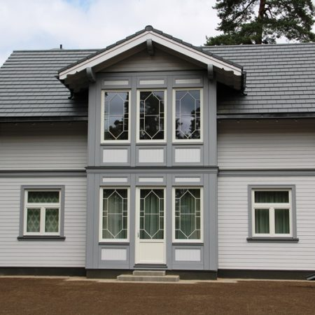 koka karkasa māja wood panel house